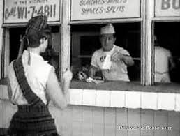 Rocky undercover at Scottie's, a drive-in restaurant where the carhops wear plaid skirts.